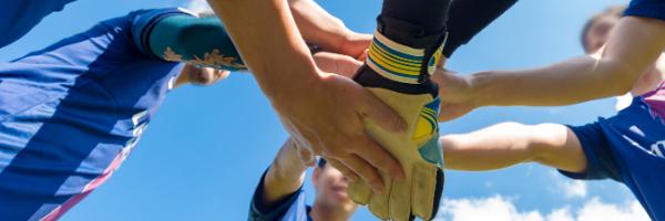teammates hands together