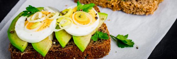 avocado and eggs on wheat toast