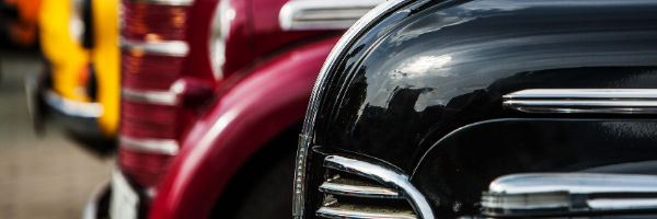 old cars in a line