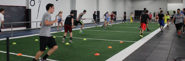 group running up and down turf