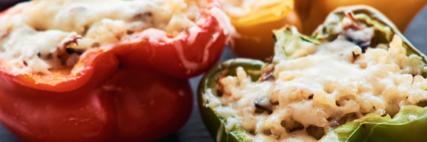 stuffed red and green pepper with cheese and meat