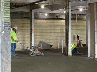 INSTALLATION OF CONCRETE TOPPING IN CONFERENCE AREA LOBBY