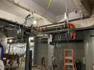 INSTALLATION OF GEOTHERMAL PIPING INTO MECHANICAL ROOM