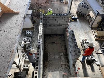 LOOKING SOUTHEAST – INSTALLATION OF ELEVATOR 2 3 SECTOR 1