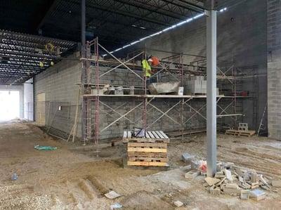 masonry installation of north wall of locker room