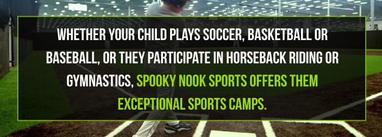 baseball player standing on Spooky Nook Sports indoor diamond