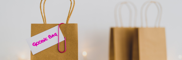 brown paper goodie bag with pink paper clip