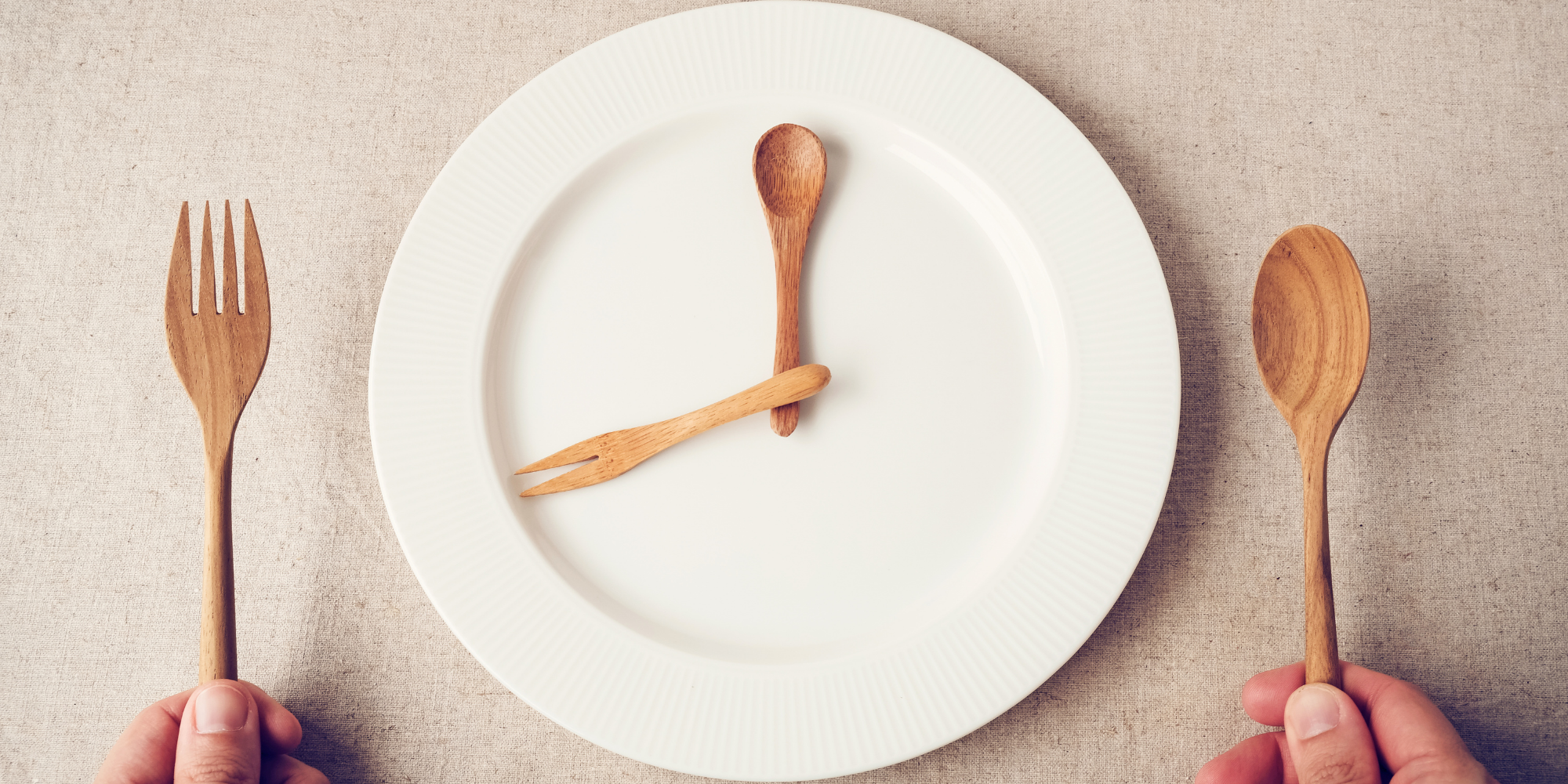 white plate with wooden spoons