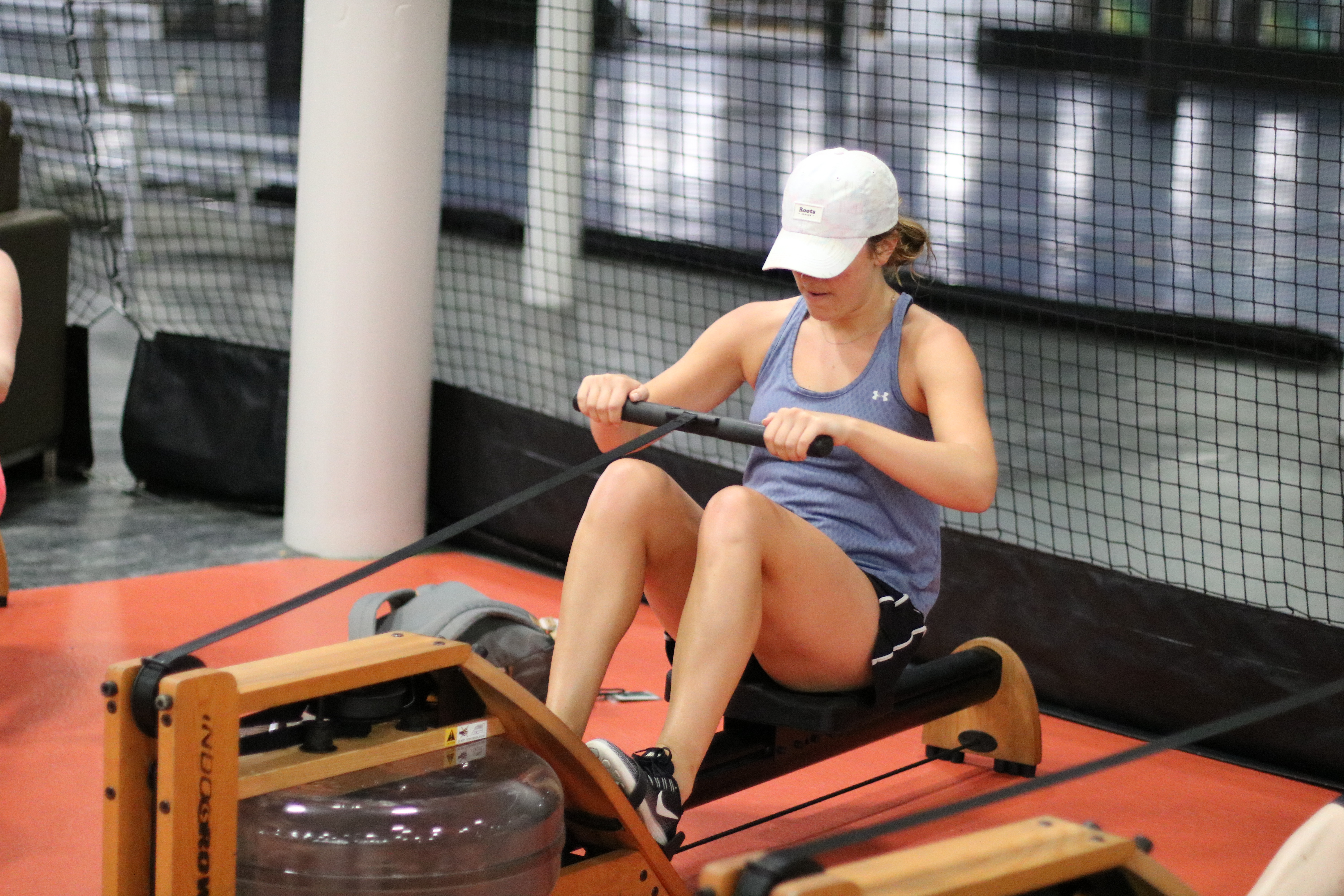 woman using rowing machine as Spooky Nook Sports