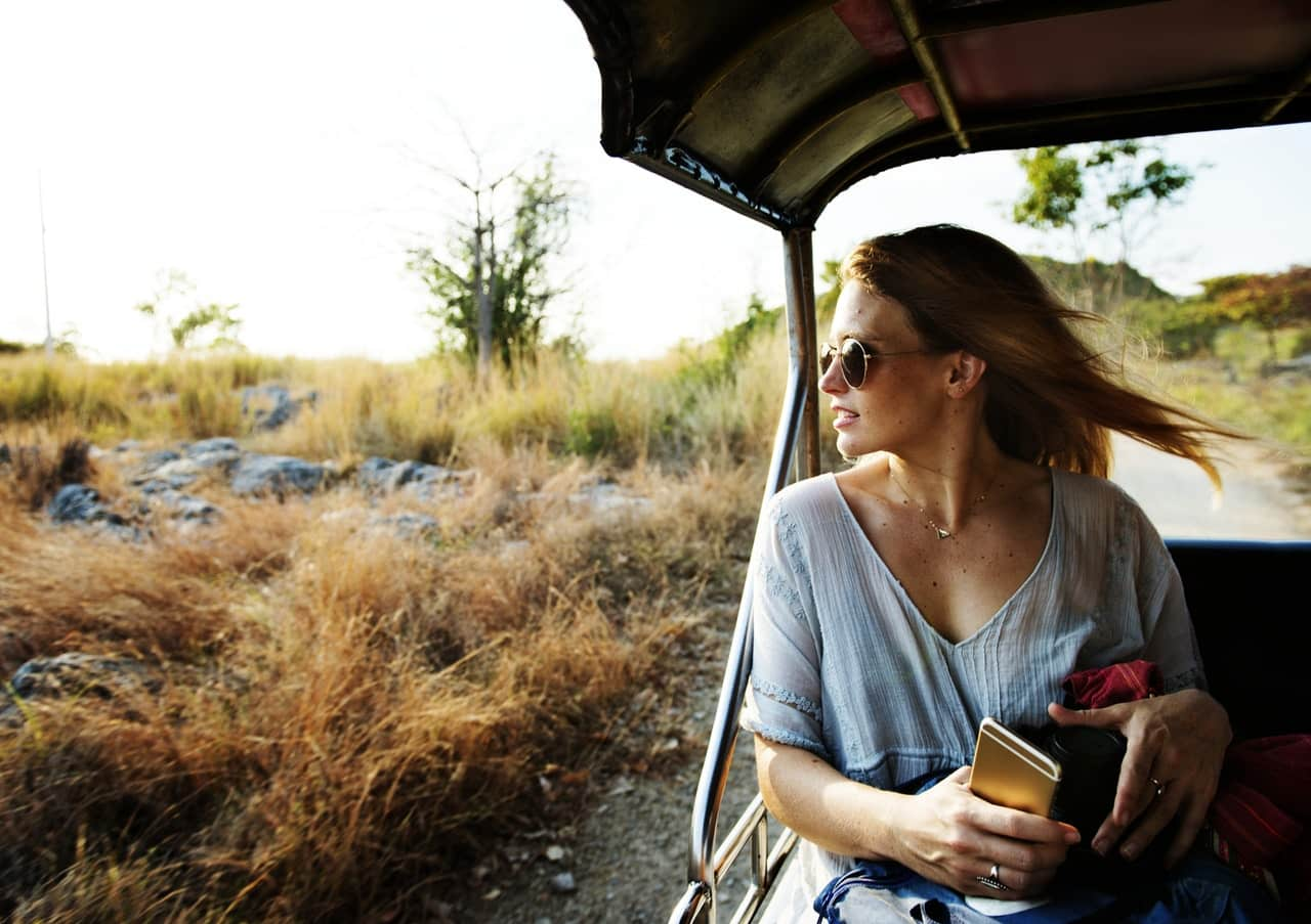 woman-traveling-roadside